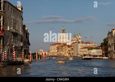 Canal or Canale Grande near Ponte dell'Accademia, Santa Maria della Salute church at back, San Marco district, Venice - Stock Photo