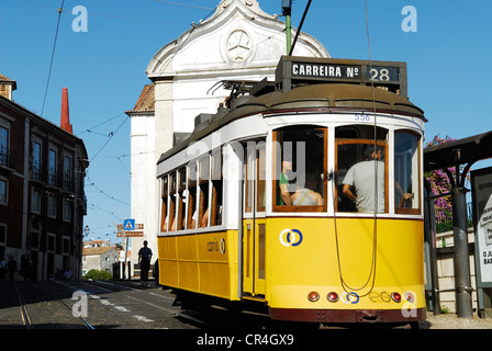 Portugal, Lisbon, Alfama District, passing of tramway along the la rua do Limoeiro in front of the Santa Luzia Church - Stock Photo
