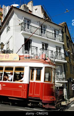 Portugal, Lisbon, Alfama District, passing of tramway along the rua das Escolas Gerais - Stock Photo
