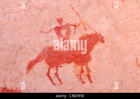 Painted rider on a horse, neolithic rockart of the Acacus Mountains or Tadrart Acacus range, Tassili n'Ajjer National - Stock Photo