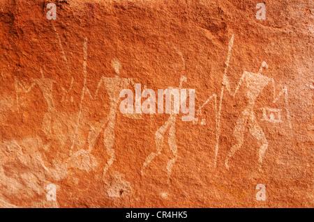 Painted warriors, neolithic rock art of the Tadrart, Tassili n'Ajjer National Park, Unesco World Heritage Site, - Stock Photo