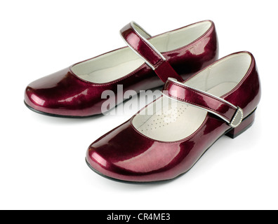 Red girls patent leather shoes isolated on white - Stock Photo