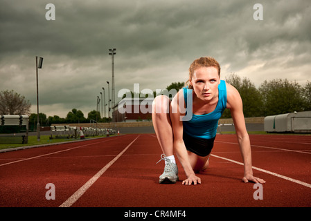 woman starting a running race - Stock Photo