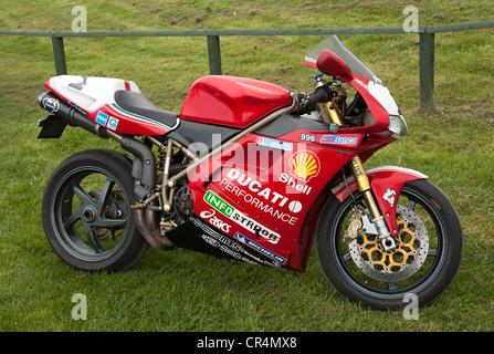Bright Red Ducati 996 Motorcycle at Oulton Park Motor Racing Circuit Tarporley Cheshire England United Kingdom UK - Stock Photo