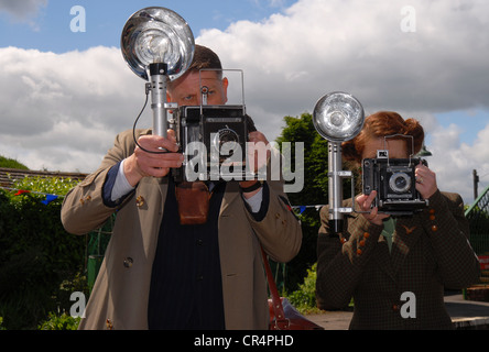 Press photographers from the 1940s photographing arrival of Winston Churchill at Medstead & Four Marks train station, - Stock Photo