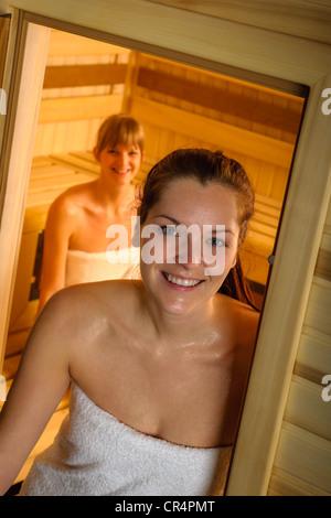 Sweaty brunette woman leaving sauna luxury spa center - Stock Photo