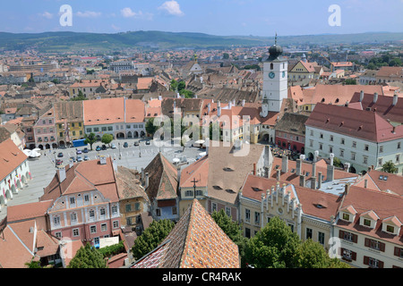 View from the tower of the Protestant church on the old town with old tower of the town hall, old town, Sibiu, Romania, - Stock Photo