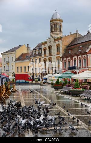 Orthodox Cathedral in the main square Piata Sfatului or Council Square, Brasov, Romania, Europe - Stock Photo
