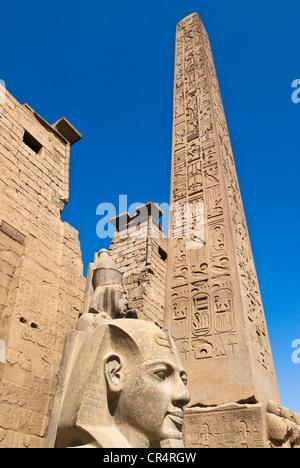 Egypt, Upper Egypt, NIle Valley, Luxor Temple UNESCO World Heritage, Ramses II's head and the Obelisk - Stock Photo