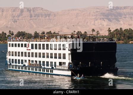 Egypt, Upper Egypt, NIle Valley, Esna, floating cruise ship near the lock - Stock Photo
