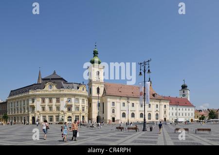 Piata Mare Square with the Catholic Church, Sibiu, Romania, Europe - Stock Photo