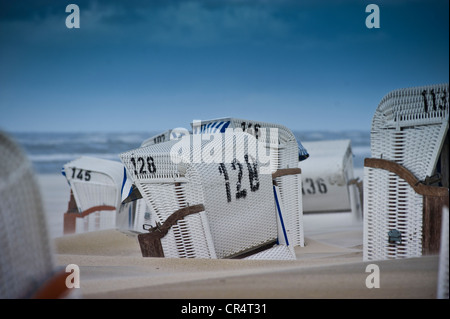 Beach chairs on the North Sea beach of Spiekeroog, East Frisia, Lower Saxony, Germany, Europe - Stock Photo