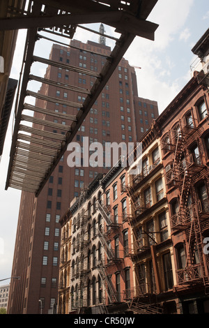 Cast iron and brick facade buildings in the New York neighborhood of Tribeca - Stock Photo