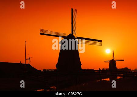 Windmills at Sunset, Schermerhorn, Schermer, North Holland, Holland, Netherlands, Europe - Stock Photo
