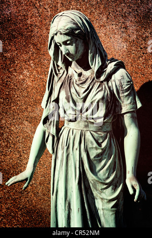 Statue of a grieving woman at Ohlsdorf Cemetery in Hamburg, Germany, Europe - Stock Photo