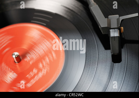 Turntable playing an LP record - Stock Photo