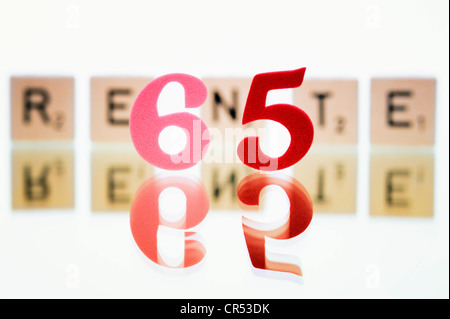 Cubes with letters forming the word 'Rente', German for 'pension', symbolic image for retirement starting at 65 - Stock Photo