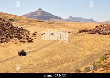 Safari vehicle in the Mik mountains, Damaraland, Namibia, Africa - Stock Photo