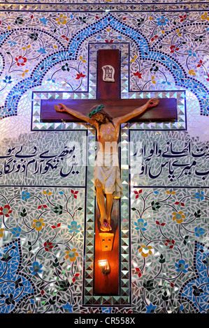 Crucifix and Arabic characters in the Parish Church of St. John, Christian community of Youhanabad, , Pakistan, - Stock Photo