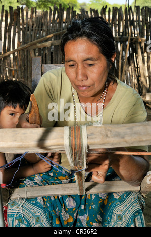 Traditional arts and crafts, woman weaving a ribbon from fibers of chaguar plants, indigenous community of Santa - Stock Photo