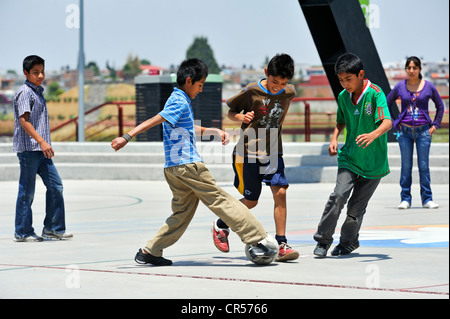 Young people playing football, Puebla, Mexico, North America, Latin America