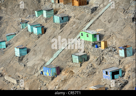Brightly painted wooden houses built on sandy slopes in the dry desert climate, slums of Amauta, Lima, Peru, South - Stock Photo