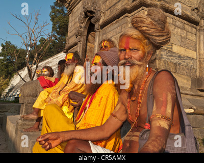 A group of Sadhus, Holy Men from India, resting at Pashupatinath temple in Kathmandu, Nepal, South Asia - Stock Photo