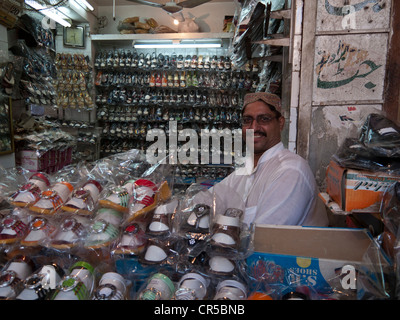 Local shoe-dealer in the streets of Lahore, Punjab, Pakistan, South Asia - Stock Photo