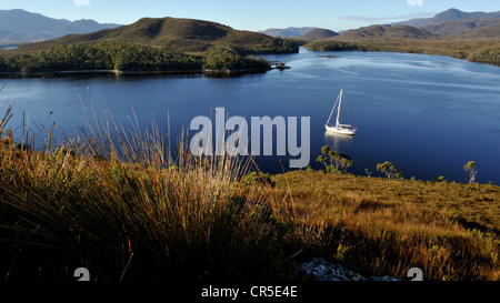 Looking south down Melaleuca inlet with a cruising yacht at anchor.  Port Davey Marine Reserve, a World Heritage - Stock Photo