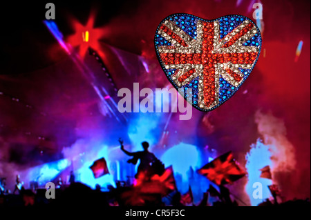 Heart shaped reflective sparkling Union Jack Flag with outdoor music party spectacular at night London UK