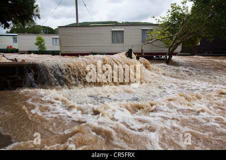 Floodwater flowing through a campsite near Aberystwyth, Wales, UK - Stock Photo