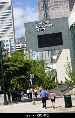 Pedestrians outside Charlotte Convention Center, Charlotte, North Carolina, USA - Stock Photo