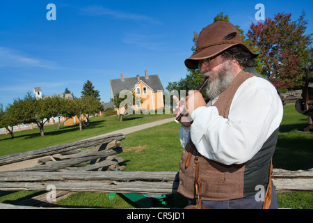 Canada, New Brunswick, Acadia, Fredericton, Kings Landing, recreated village, flute player in front of the Maison - Stock Photo