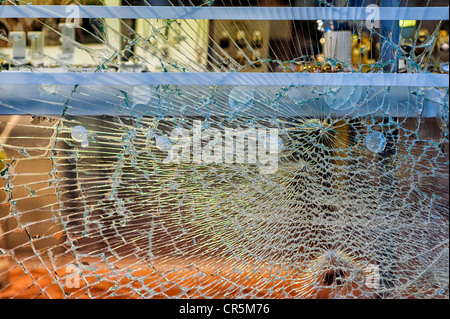 Smashed front window of a jewellery shop - Stock Photo