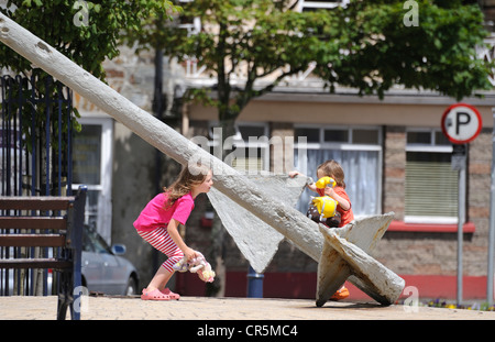 Children playing in Wolfe Tone Square, Bantry, West Cork, Republic of Ireland - Stock Photo