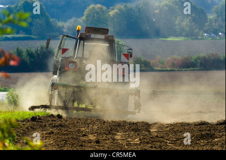 Farmer with a tractor during field work in autumn, Grevenbroich, North Rhine-Westphalia, Germany, Europe - Stock Photo