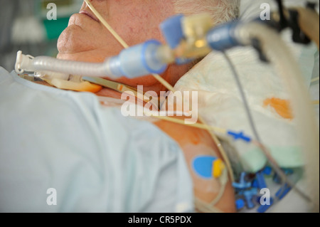 An intensive care unit (ICU) with an elderly female ...