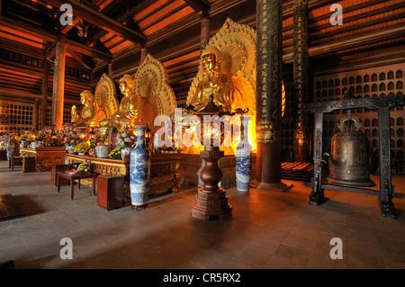 Three gold-plated Buddha statue, Pagoda Chua Bai Dinh, Ninh Binh, Vietnam, Southeast Asia, Asia - Stock Photo