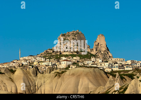 The village of Uchisar with its rock castle amidst the tufa landscape of Cappadocia, Central Anatolia, Turkey - Stock Photo