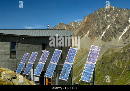 The futuristic Velan Hut, Cabane du Velan, of the Swiss Alpine Club, SAC, with its six solar panels in front of - Stock Photo