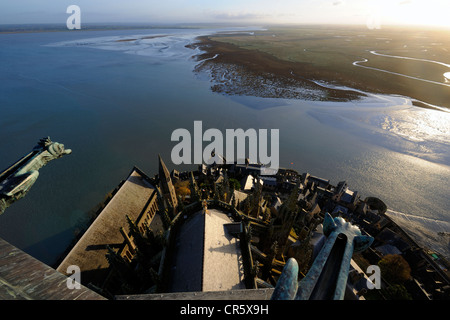 France, Manche, the abbey of Mont Saint Michel, UNESCO World Heritage, Apse and bay seen from the spire at dawn - Stock Photo