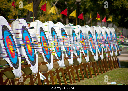 arrows in archery targets at tournament - Stock Photo