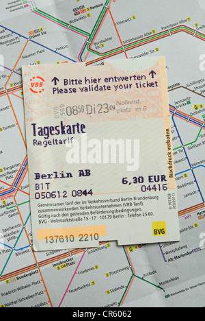BERLIN, GERMANY. A validated tageskarte (travel card) on a map showing the Berlin U- and S-Bahn public transport - Stock Photo