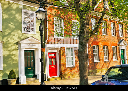 Listed buildings in a tranquil sun-dappled street. The Causeway, Horsham, West Sussex, England, UK - Stock Photo
