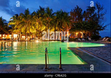Mauritius, East Coast, Flacq District, Belle Mare, Ambre Apavaou Hotel, swimming pool by night on the seaside - Stock Photo