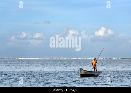 Mauritius, East Coast, Flacq District, Belle Mare, Palmar Beach, boat returning from fishing - Stock Photo