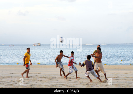 Mauritius, East Coast, Flacq District, Belle Mare, Palmar Beach, Rugby game in the late afternoon - Stock Photo
