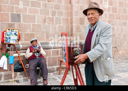 Peru, Cuzco Province, Cuzco, listed as World Heritage by UNESCO, photographers on the square of San Francisco Church - Stock Photo
