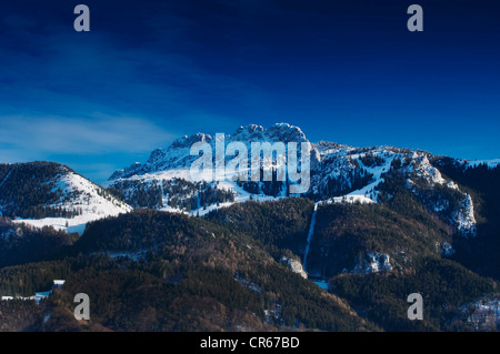 View of the Chiemgau Alps as seen from lake Chiemsee, Kampenwand massif, Bavaria, Germany, Europe - Stock Photo