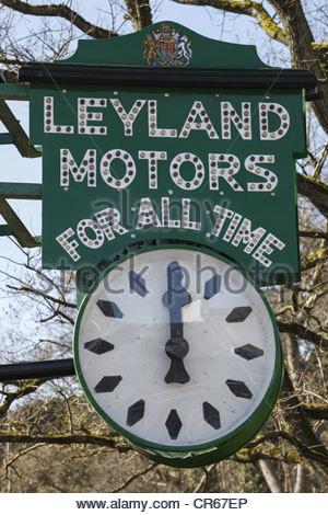 Garage clock Kendal Cumbria England - Stock Photo
